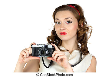 Portrait of the cute woman with camera