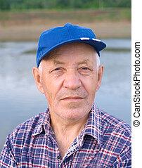 elderly man in cap
