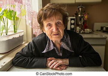 Portrait of the elderly woman.