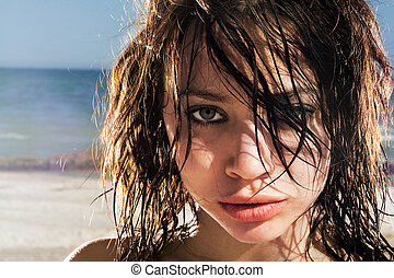 Portrait of the expressive young woman on a beach
