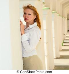Portrait of the girl among columns
