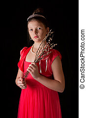 Portrait of the girl in a red dress on a black background