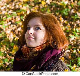 Portrait of the girl in autumn