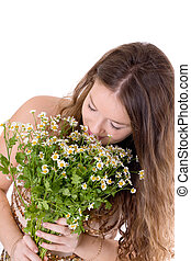 girl with a bouquet of camomiles