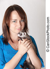 girl with a domestic polecat
