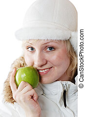 Portrait of the girl with a green apple