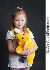 girl with a yellow elephant