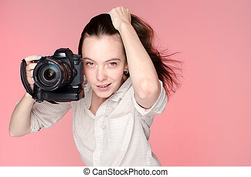 Portrait of the girl with camera in her right hand