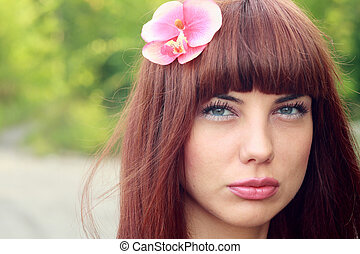 girl with flower in hair