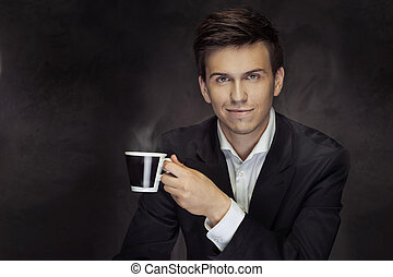 Portrait of the handsome mna holding the coffee cup