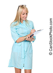 Portrait of the happy young nurse of filling paper on a...