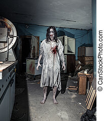 Portrait of the horror zombie woman. Halloween. - Portrait...