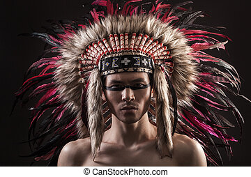 Portrait of the indian strong man posing with traditional...
