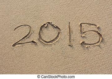 """the inscriptions """"2015"""" on sand beach"""