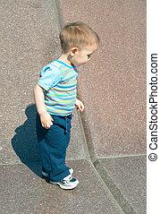 boy against stone wall