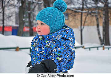 portrait of the little boy in the winter