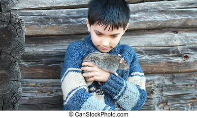 Portrait of the little boy with a domestic rat