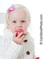 Portrait of the little girl with a red apple