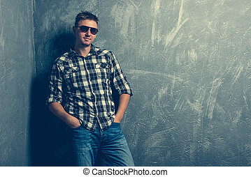 man in sunglasses and plaid shirt