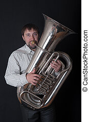 man playing a tuba