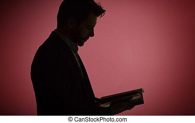 Portrait of the man reading a magazine