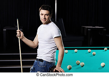 Portrait of the man with cue