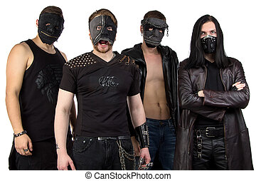 Portrait of the metal band in black clothes