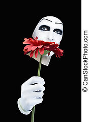 Portrait of the mime with a red flower on a black background