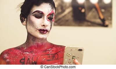 Portrait of the model shooting selfie - Face art. Portrait...