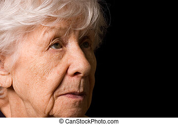 Portrait of the old woman a black background