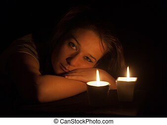 girl by the light of candles