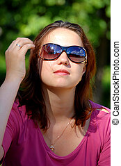 Portrait of the Russian girl in eyeglasses in the summer