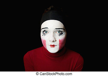 Portrait of the sad mime on a black background