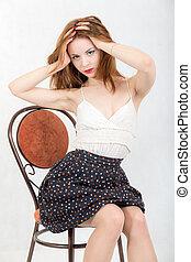 sensual girl on a chair