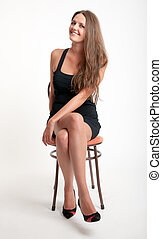 slim girl on a chair