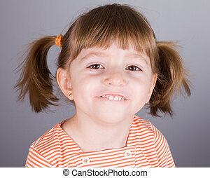 Portrait of the small smiling girl