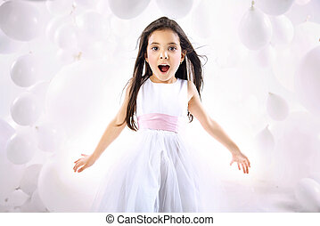 Portrait of the surprised little girl