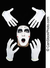surprised mime on a black background