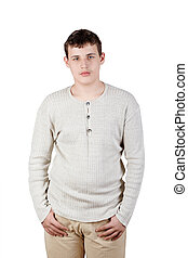 Portrait of the teenager which stands thrusting his thumbs in trouser pockets