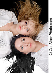 Portrait of the two lovely blonde and brunette