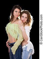 Portrait of the two sexy pretty girlfriends
