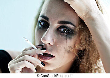 Portrait of the woman smokes