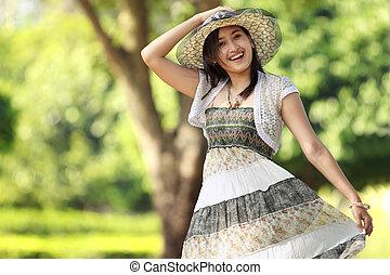 young asian beautiful smiling woman outdoors