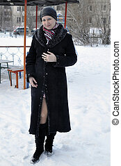 Portrait of the young beautiful woman in the winter on the stree