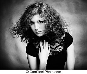 Portrait of the young beautiful woman with curly hairt. Vintage