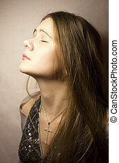 young girl with closed eyes