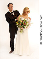 Portrait of the young happy newlyweds on white background