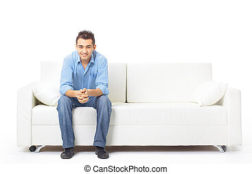 Portrait of the young man in white on sofa