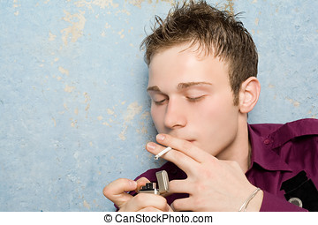 portrait of the young man with a cigarette