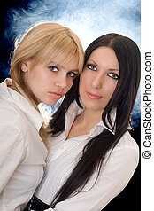 Portrait of the young pretty brunette and blonde